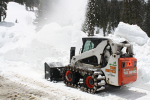 Small tractor clearing snow